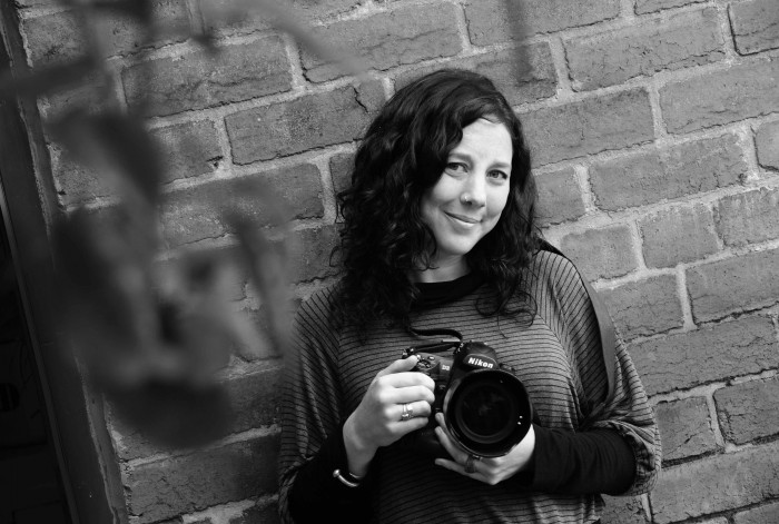 Image of wedding photographer Laura Page holding her camera