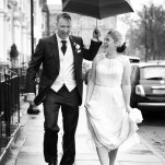 picture of a married couple walking down a street