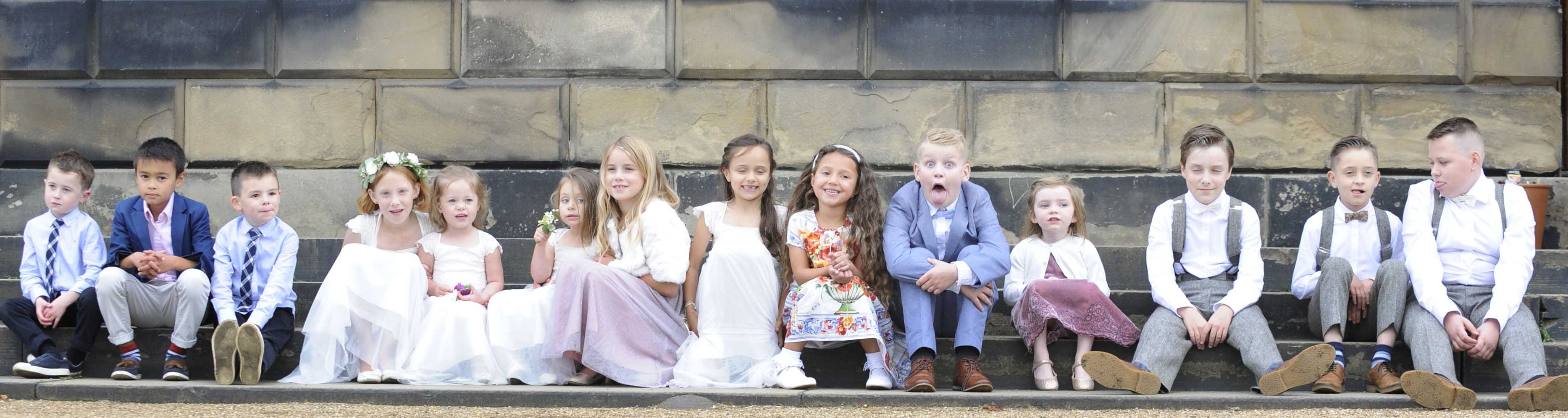 kids sat on a step at a wedding
